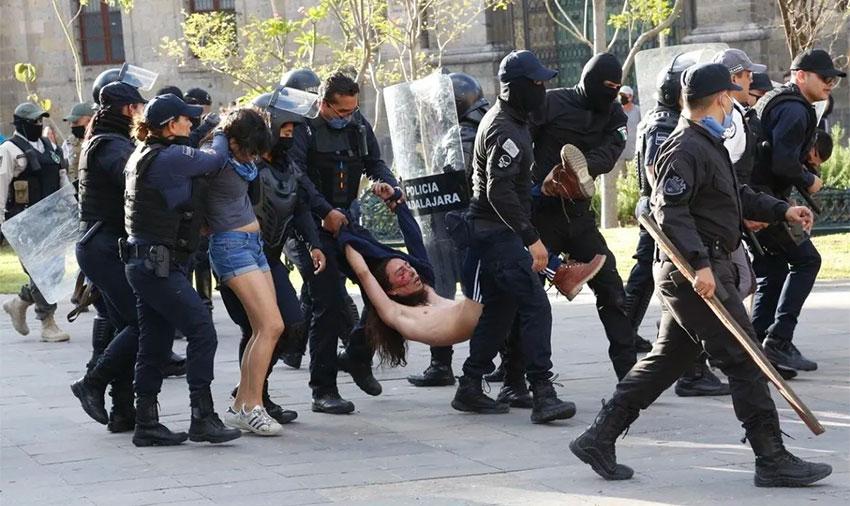 Police in Guadalajara arrest protesters in June.