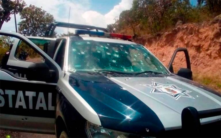 A bullet-riddled police vehicle after the attack in Durango.