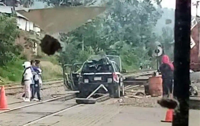 A police vehicle blocks the tracks in Uruapan.