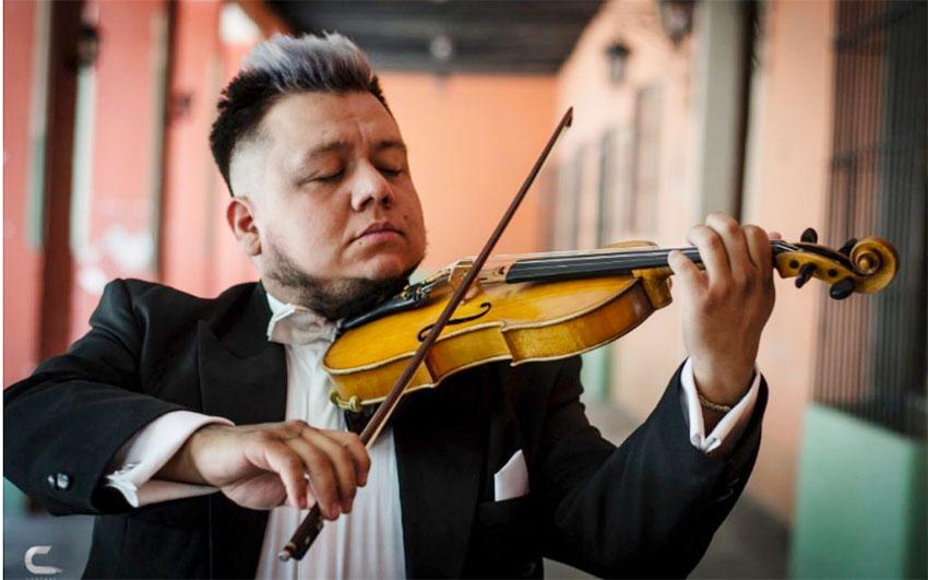 Violinist Genghis Díaz keeps himself employed.