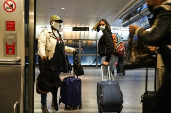 Many Americans this year are risking packed airports and potentially unsafe Thanksgiving get-togethers.