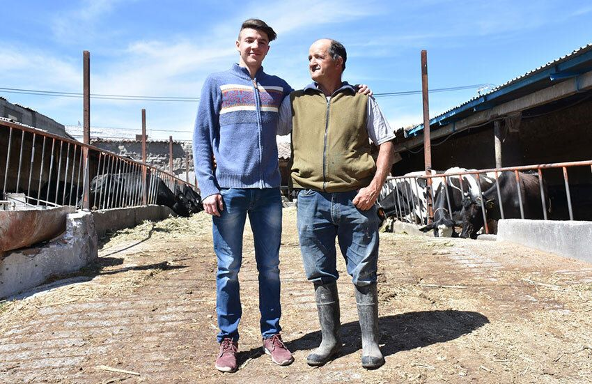 Flavio Stefanoni Merlo (left) plans to succeed his father Luís (right), a fourth-generation dairyman. He'll be a dying breed in Chipilo.