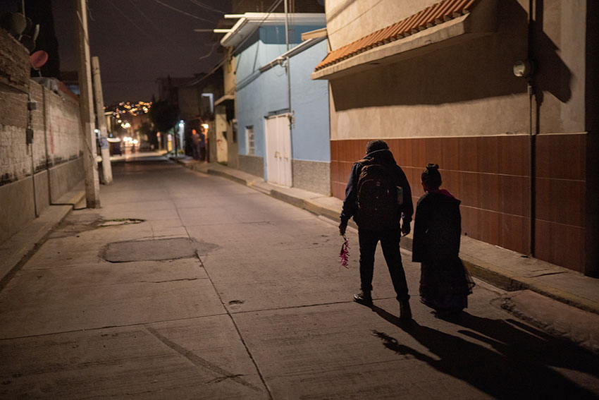 Lidia and her youngest daughter Camila walk home together in Chimalhuacán