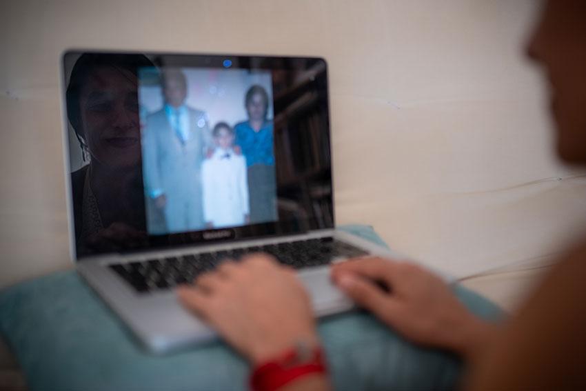 Diana Fidelia looks through old photos of her brother Ricardo.
