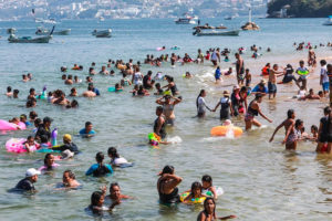 A busy Acapulco beach on the weekend.
