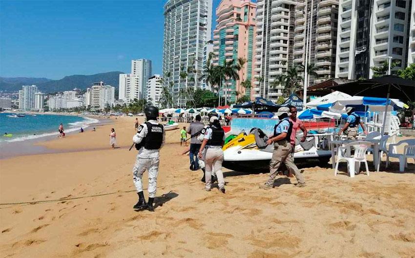 Officials patrol a beach in Acapulco.