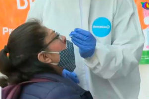 A woman is tested for Covid at a Mexico City testing station.