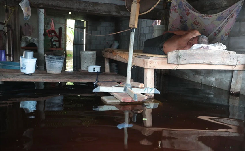 Beds are raised above water level to allow people to sleep.