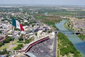 Nuevo Laredo on the left and Laredo on the right, divided by the Rio Grande river.