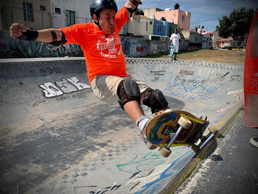 Fifty-six-year-old Álvaro Gutierrez performing a Frontside Grind.
