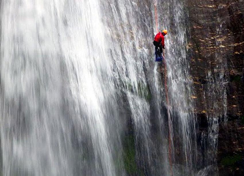 Medina rappelling down a waterfall in Syange Khola Canyon, Nepal.