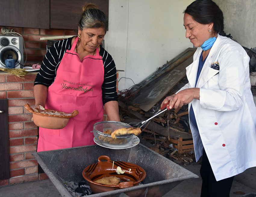Fernández cooks her dish in a clay pot over charcoal, and swears by the difference in flavor.