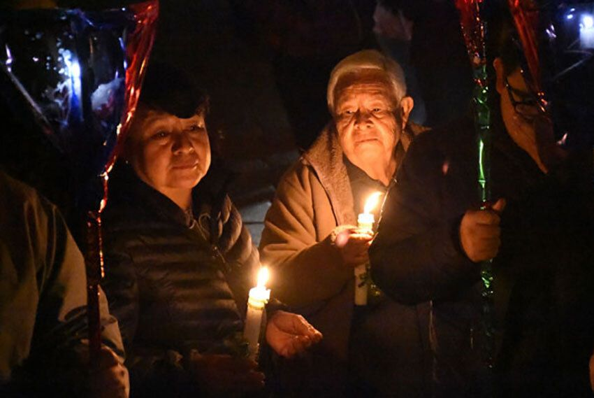 Posada processions through the neighborhood are a candlelit affair.