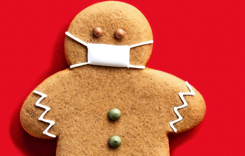 Holiday gingerbread person updated for gift giving in the current era.