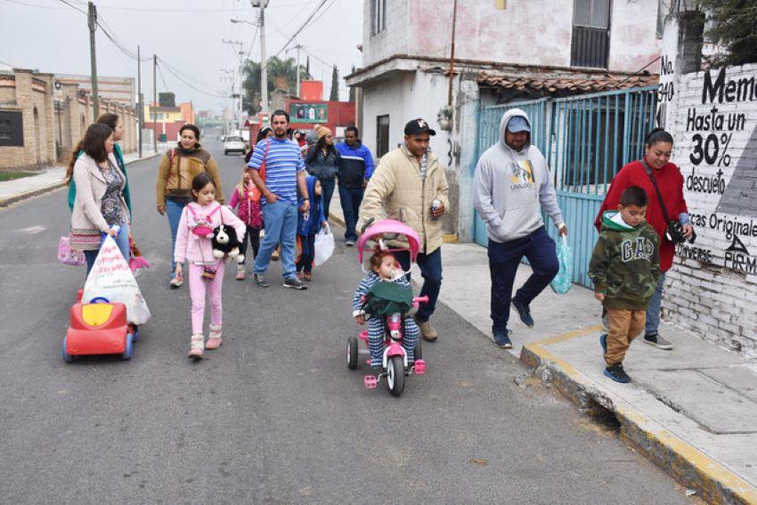 Participants go door-to-door to wish neighbors a good upcoming year.