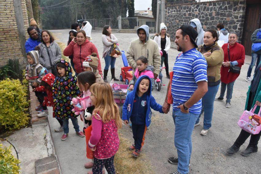 Chipileños sing at one of their neighbors' doors.