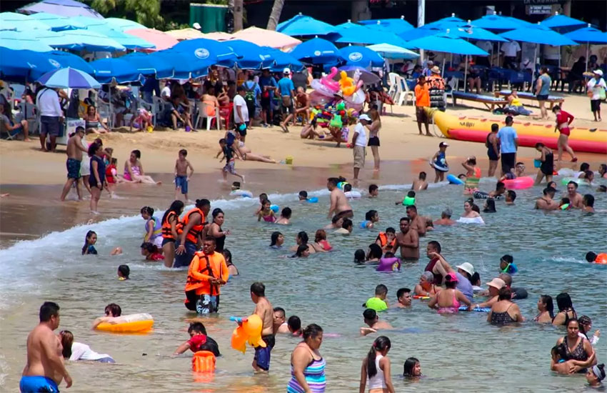A busy beach in Acapulco last March.