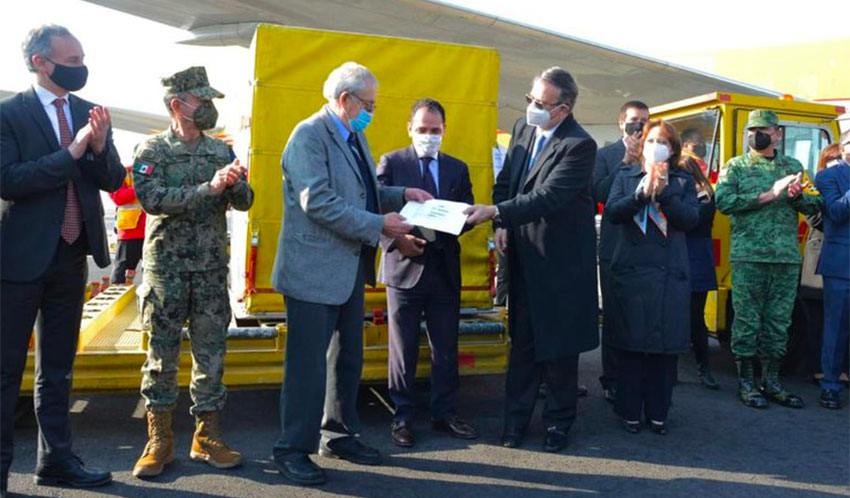Senior officials welcome the arrival of the Covid vaccine at the Mexico City airport.