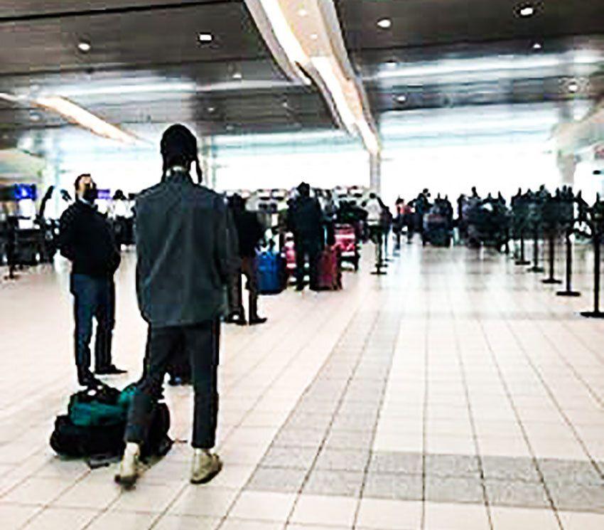Passengers wait to board at Toronto Pearson International Airport.