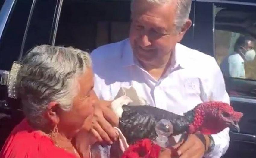 Angélica Lara of Santa Ana presents the president with a turkey