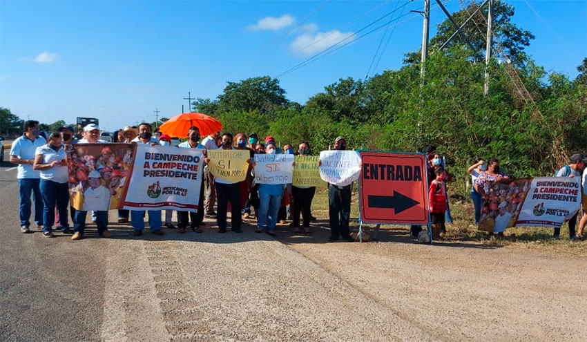 Protesters who want the Maya Train's route shifted await the president in Campeche.