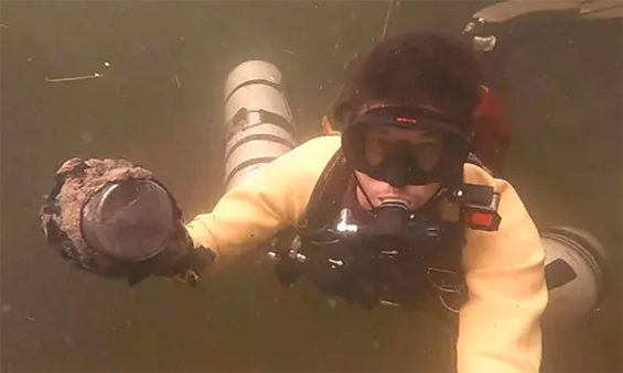A diver with one of the meters found in a Yucatán cenote.