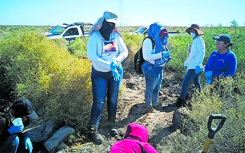 Searchers dig up a clandestine grave in Sonora.