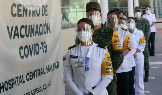 Candidates for Covid vaccination line up at a military hospital in Mexico City.