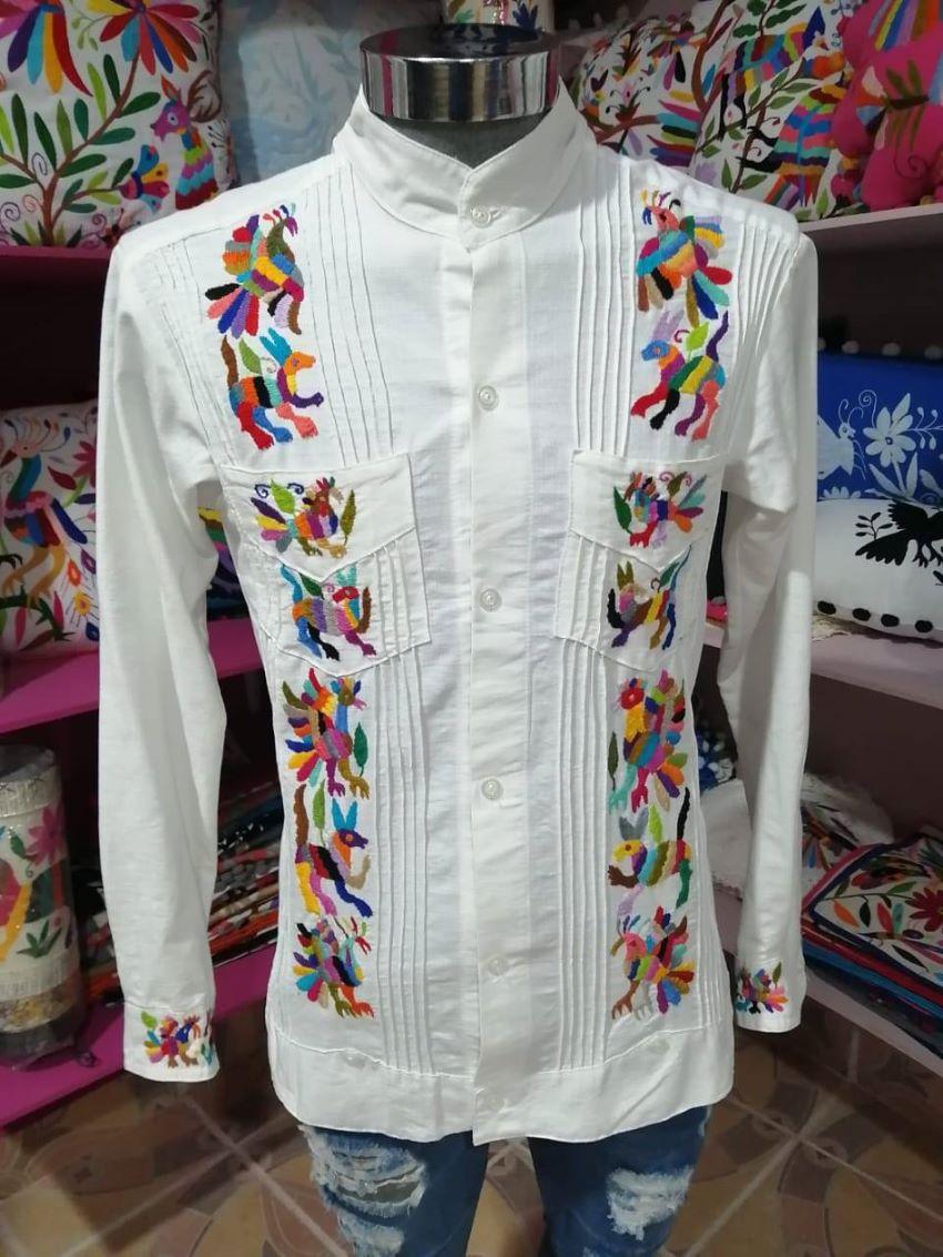 Guayabera-style shirt with Tenango embroidery by Tonani Lirio de los Valles in Hidalgo.