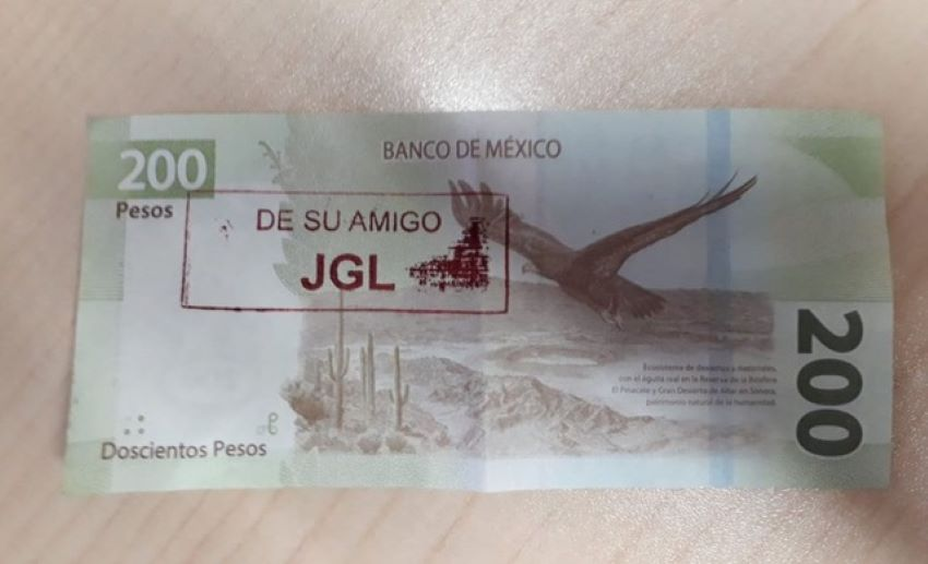 "In 2020, these bills with jailed drug lord Joaquín ""El Chapo"" Guzmán Loera's initials appeared in Culiacán, evidence of cartels' influence in Mexico's economy."