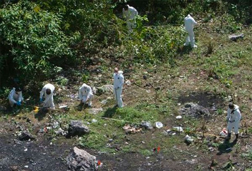 Investigators at the Cocula dump, initially identified as the location where the missing students' bodies were incinerated.