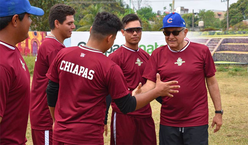The president with members of the Guacamayas at their home stadium in Palenque.