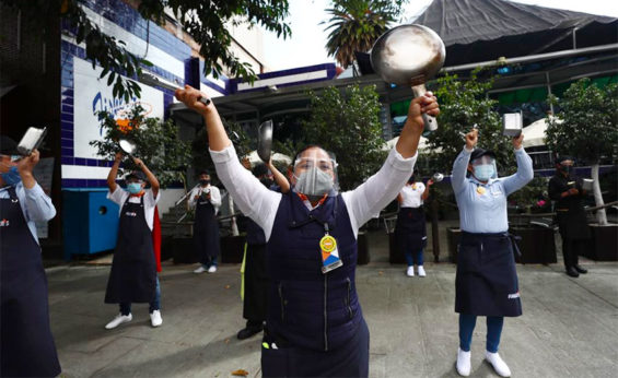Restaurant workers make some noise in Mexico City.