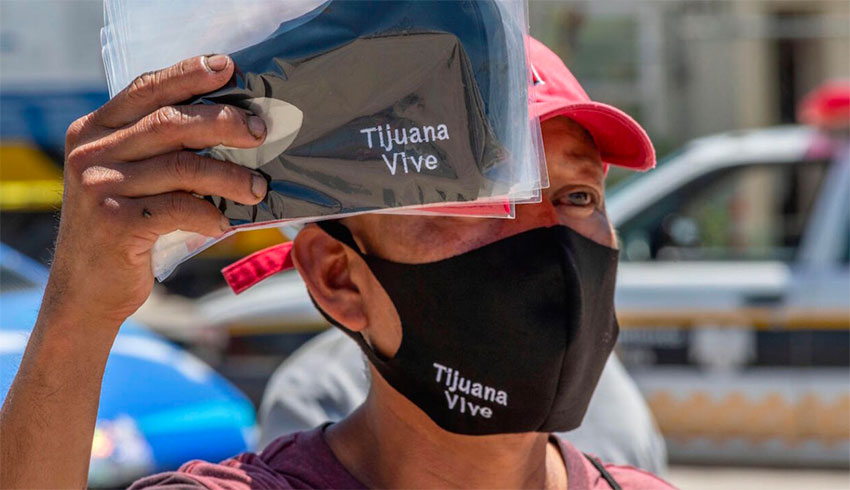 A man sells face masks in Tijuana,