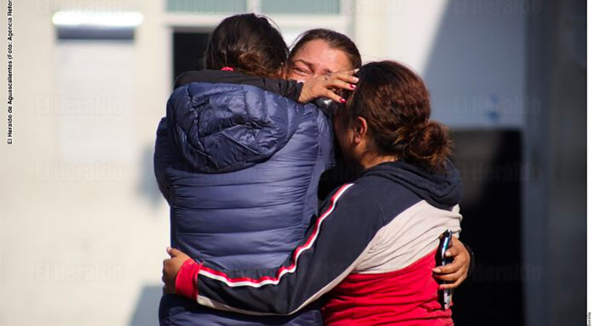 Family members grieve the death of a victim of the coronavirus.