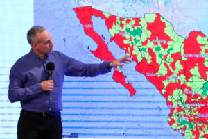Deputy Health Minister Hugo López-Gatell and a map indicating the municipalities of hope.