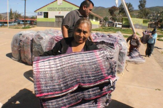 Distributing blankets for the frigid winter nights in Baja California.