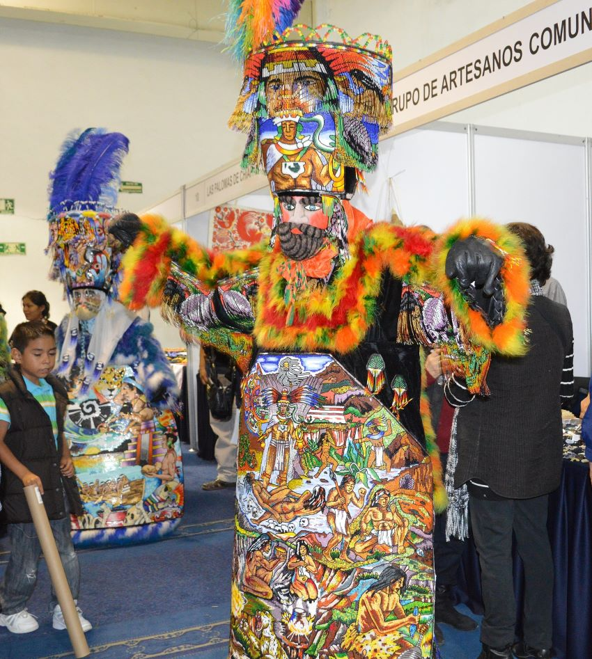 Chinelos dancers with highly-ornate garb performing for the opening of the Expo de los Pueblos Indígenas in Mexico City in 2018.
