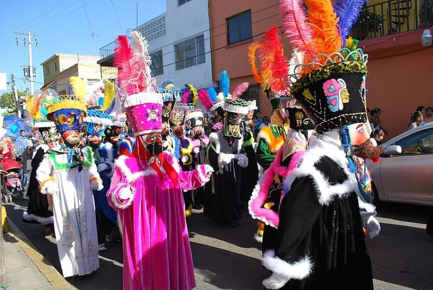 Chinelos accompany the image of the Niñopa (a baby Jesus statue) in the Mexico City borough of Xochimilco during an annual procession.