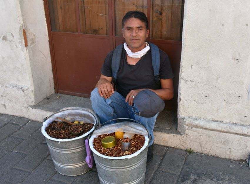 """Now, there are days when I earn nothing,"" says vendor José Mejia Morales about his business selling snacks on Cholula's streets."