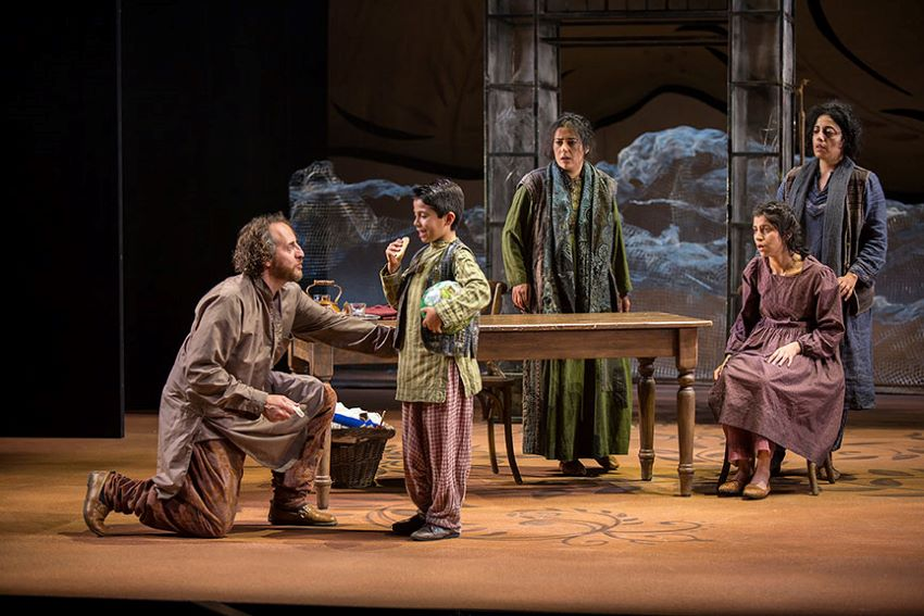 "Arden Pala onstage playing the character of Zalmai in San Diego's Old Globe theater production of ""A Thousand Splendid Suns."""