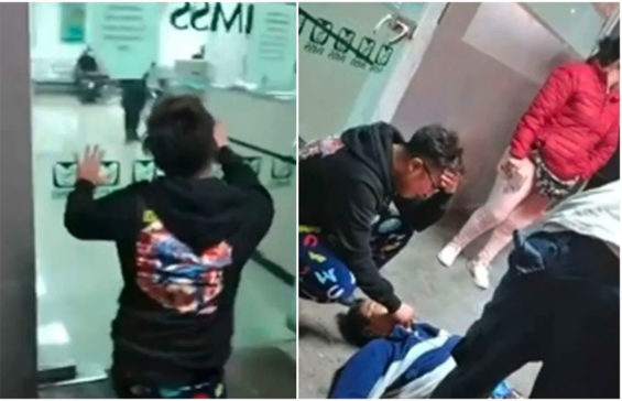 The dead man's son, left, pleads with hospital personnel to open the door