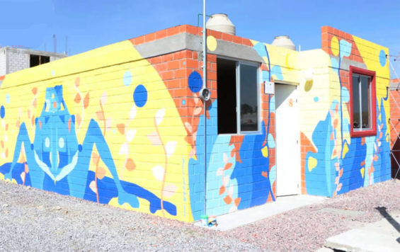 Murals adorn the first two houses in a new sustainable housing program.