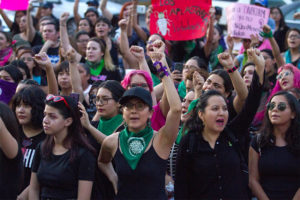 Women march against gender violence at a Mexico City protest in 2019.
