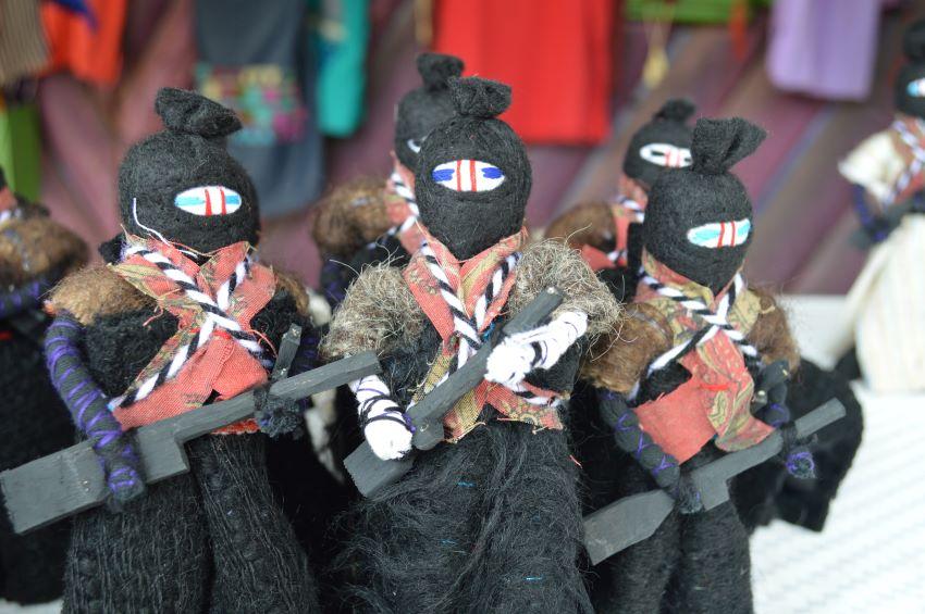 Zapatista dolls with trademark balaclava, rifle and bandolier.