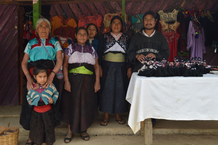 Textile artisan Maria Pastishtan (far left) and family outside of their workshop and store in San Juan Chamula.