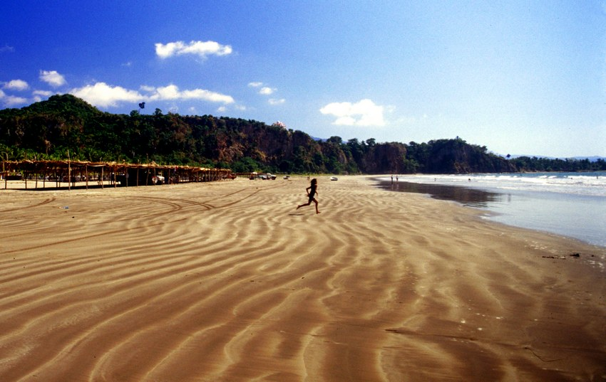 Long, beautiful Los Cocos beach has soft sand and small waves.