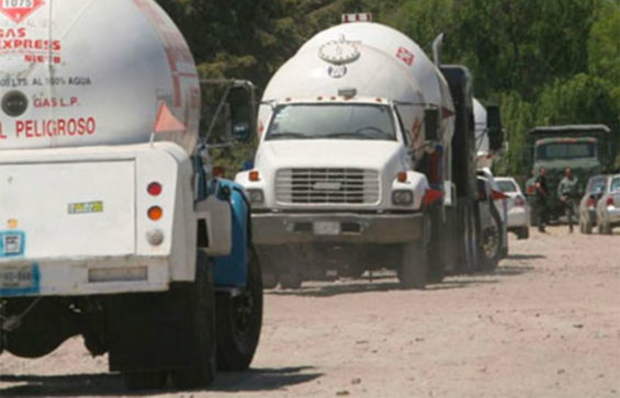 Tanker trucks at the scene of an LP gas pipeline tap.
