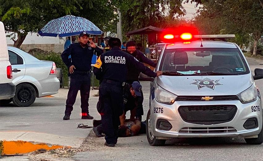 police pin down woman in Tulum