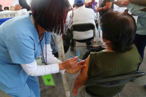 A healthcare worker administers a vaccine shot in Hidalgo.